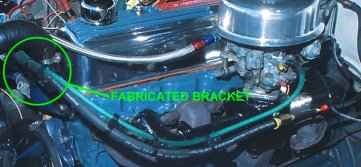 ...bracket fabricated for PCV hose and HEI distributor vacuum advance unit.
