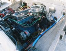 1961 Chevy Apache pickup truck 235 cubic inch displacement 6 cylinder engine after August 2009 detail and retrofit, carburetor side of engine view.