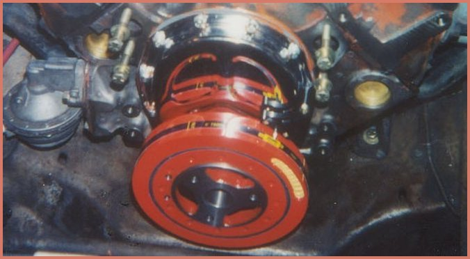 Photo shows a Carter high performance high volume standard psi fuel pump, Summit Racing Equipment chrome timing cover and nodular harmonic balancer assembly installed on  350 c.i.d. engine in the 1971 Chevrolet C10 pickup truck. Not seen in the photo is the Cloyes double roller timing chain assembly which was installed.