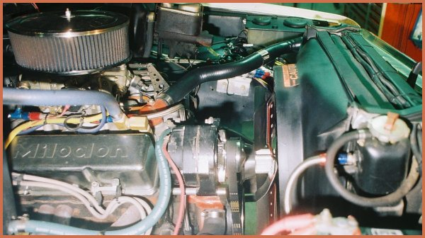 PHOTO M 24.1 shows a close-up of the passenger side view of the 350 c.i.d. V8 engine in the 1971 Chevrolet C10 pickup truck circa APRIL 2011.