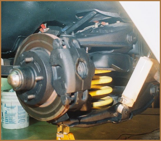 PHOTO M4 shows the Rancho Suspension 9 position adjustable no lift front shock absorber installed on the 1971 C-10 which easily adjusts with a double O-ring sealed control knob ( seen in the photo as the black knob on the lower part of the shock ). The Rancho Suspension RS9000XL shock features a tri-tube monoflow design for maximum cooling efficiency and fade resistance, urethane bushings for maximum durability, a full displacement piston with a Nitrile piston seal, a internal rebound bumper and a 5/8 inch diameter hardened, double-chromed rod.