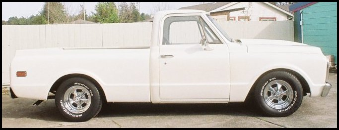 MARCH 2011 : Overall passenger side view of the installed B F Goodrich Radial T/A's, the Cragar SS wheels and the RideTech black powder coated wheel plates on the 1971 Chevy C-10 pickup.